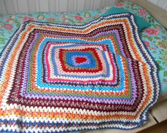 crocheted blanket or small square blanket