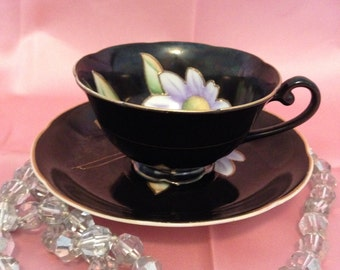 Occupied Japan cup & saucer, Floral centre, Raised gold gilding