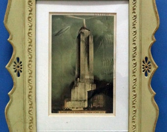 Framed Postcard Empire State Building 1932 Dirigible or Blimp or Zeppelin and Search Lights