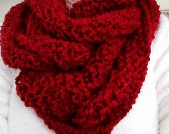 This is a candy apple colored long infinity scarf