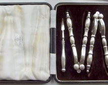 Antique Mappin and Webb Nutcrackers together with nuts picks