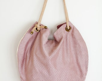 Round bag with perforated pink suede