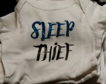 Sleep thief bodysuit. Custom glitter htv  bodysuit, baby shower gifts