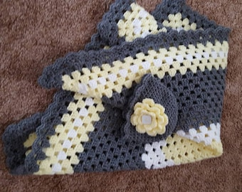 Crochet yellow, white, and grey granny square baby blanket with matching hat