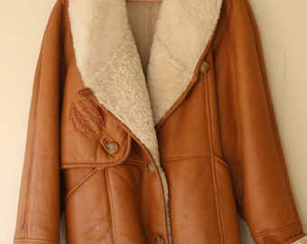 Leather shearling with beautiful embroider, original vintage from the 1970s