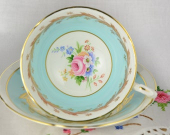 Paragon blue mismatched cup and saucer
