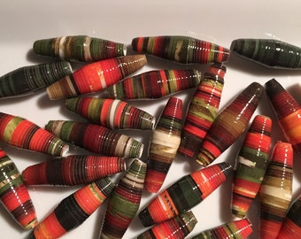 Slender, oval multi-colored paper beads. Set of 25.