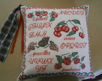 red berries cushion