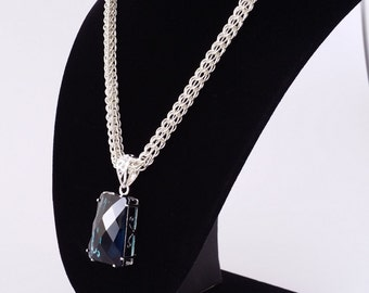 Blue topaz pendant set in silver on silver full persian weave chainmaille necklace