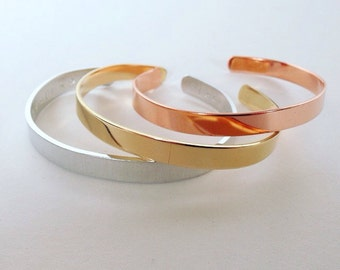 The 'simple is beautiful' cuff bracelet shaped by hand.  aluminum brass copper personalised