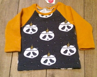 Panda and mustard yellow raglan top.
