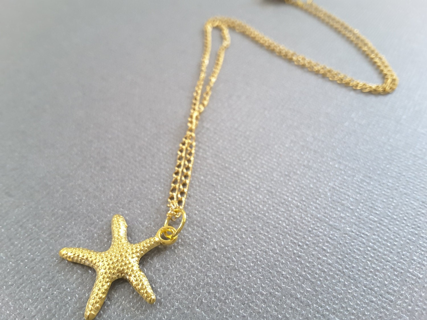 gold starfish charm necklace
