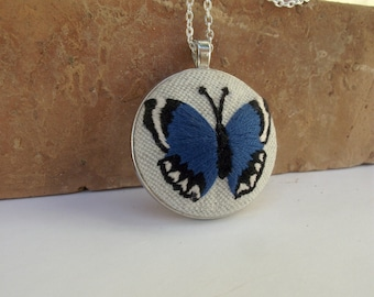 Embroidered pendant with blue butterfly