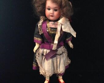 Antique German bisque head cabinet doll.