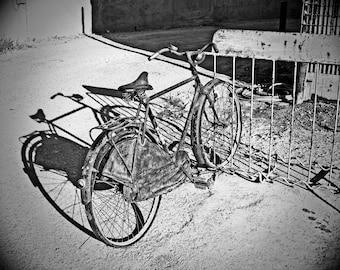 Vintage bicycle, black and white photograph, fine art photography, old bike, bike rack, sidewalk, handlebars, wheel, spokes, rustic, old
