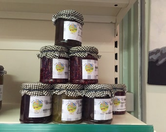 FOUR jars of jams & marmalade