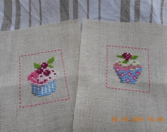 Two cakes embroidered cross stitch