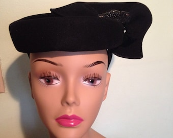 WOW sculpted wool hat with beaded embellishment and back of head occipital strap