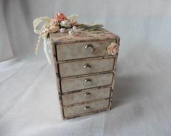 Altered matchbox dresser