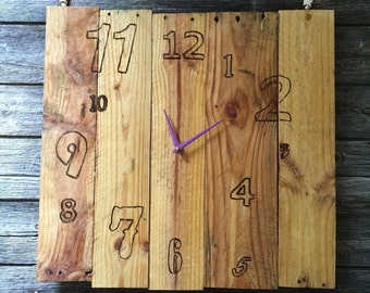 Clock made from recycled boards.