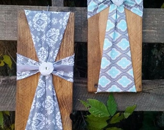 Fabric cross on reclaimed wood