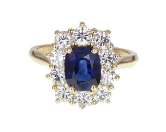 Cushion Cut Blue Sapphire and Diamond Cluster Ring in 18ct Gold