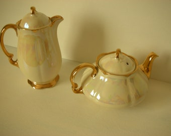 Creamer and Coffee pots cream and gold trims