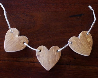 Triple heart horizontal crafted from a french oak aged wine barrel.