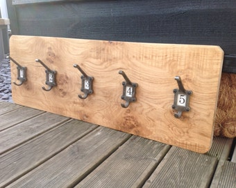 Rustic oak coat hanger with cast iron hooks and ceramic inserts 1 - 5