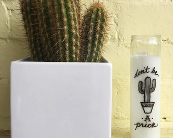 "White ""Don't be a prick"" candle"