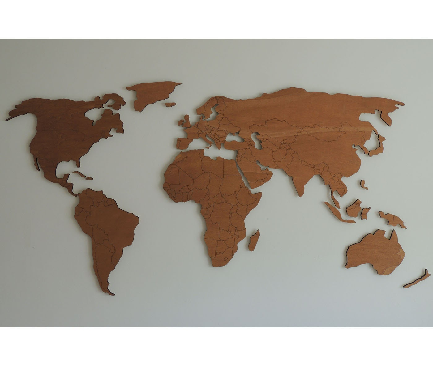 3d wooden world map with engraved land borders floating on. Black Bedroom Furniture Sets. Home Design Ideas