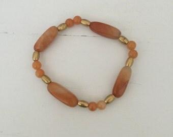 Orange Amber glass beaded bracelet