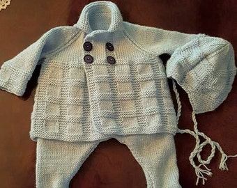 Textured knit baby jacket, pants, and hat