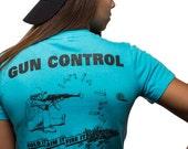 Gun Control - Hold It Aim It Fire It - Man Sitting Womens T Shirt