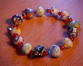 """The """"Flounder"""" - Colorful mixed media lampwork bracelet with crystal heart charm"""