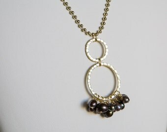 Iridescent brown freshwater pearl pendant on gold colored beaded chain necklace