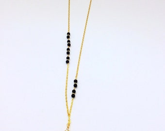 Gold plated chain with beaded detail and pendant