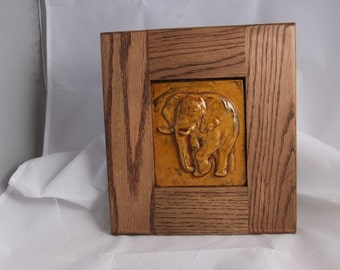 ceramic art tile of elephant in amber