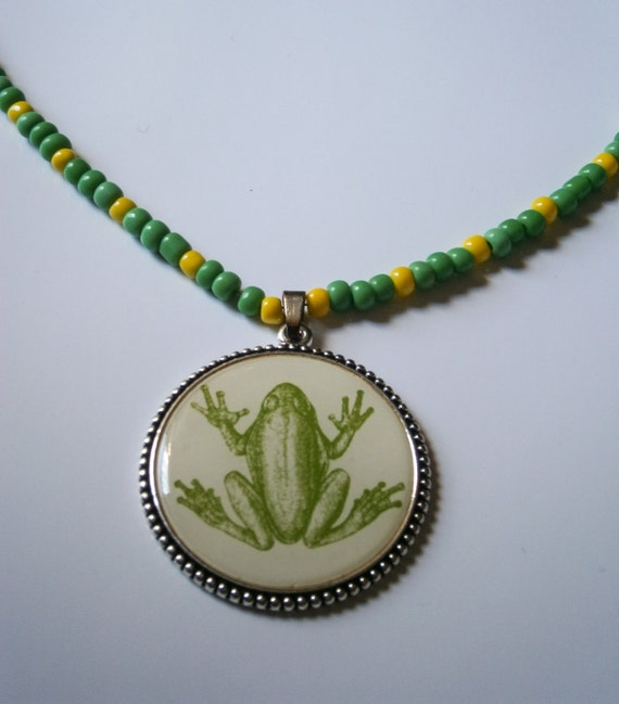 Beaded Necklace: Green and Yellow Beaded Necklace with Metal Frog Pentant