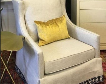 Pair of club chairs with decorative tape trim, swivel