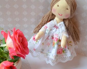 The rag doll Mary doll in handmade dress doll brown hair doll games and of the interior little doll for a gift.
