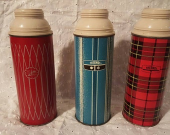 Three vintage pint size thermos