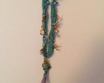 embellished fabric necklace