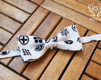 Bow tie with printed symbols