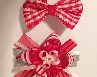 2 red bows with alligator clips