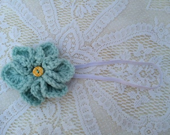 Handmade crochet flower on elastic headband