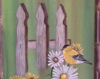 Goldfinch and daisy