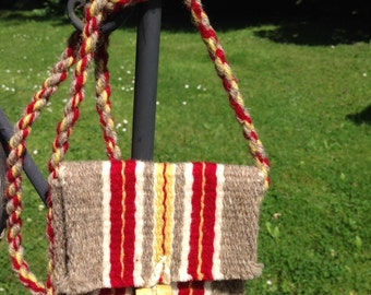 Woven wool purse with bright red stripes