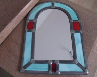 pretty stained glass and wrought iron mirror