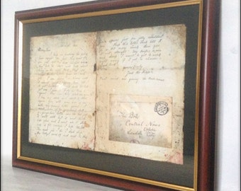 Dear Boss aged reproduction of Jack The Ripper letter in frame.